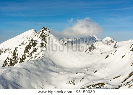Whirl Of Clouds Over The Summit A Mountain