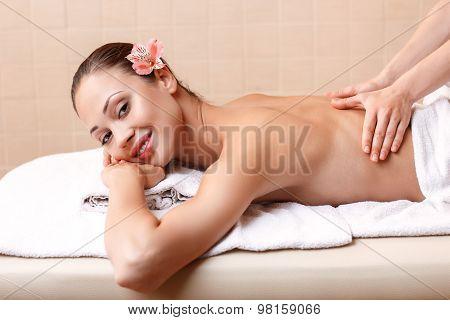 Professional massager making massage