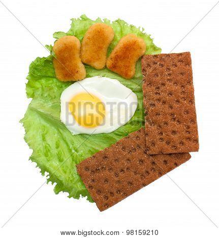 Breakfast: Fried Eggs, Lettuce, Crisp Bread And Nuggets