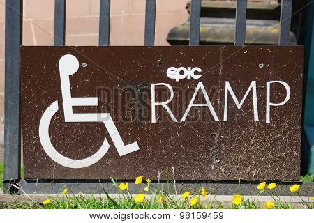 Disabled ramp access sign.