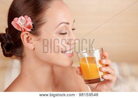Nice woman drinking juice