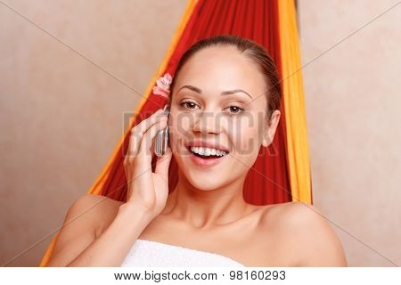 Nice woman sitting in spa salon
