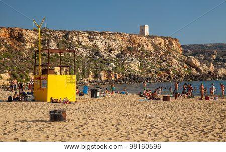Sunbathing At Golden Bay In Malta