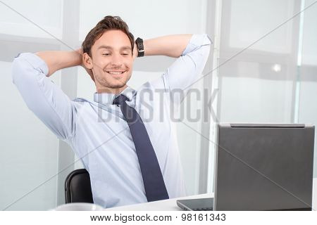 Lively call center operator holding hands on neck