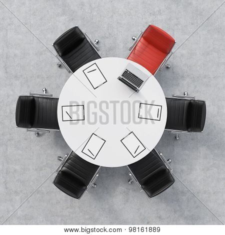 Top View Of A Conference Room. A White Round Table, Six Chairs, One Of Them Is Red. A Laptop And Fiv