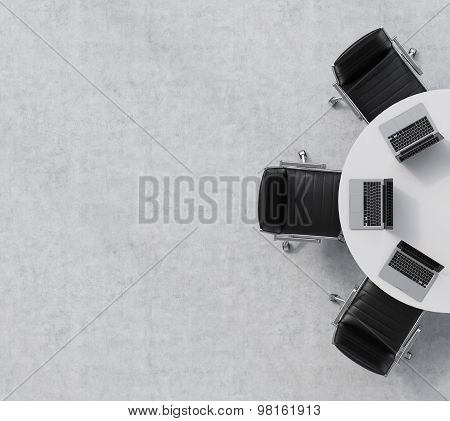 Top View Of A Half Of The Conference Room. A White Round Table, Three Black Leather Chairs. Three La