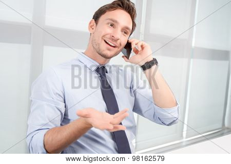 Call center operator talking on mobile phone