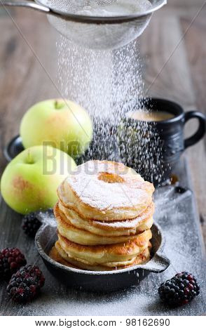 Dusting With Icing Sugar Over Apple Fritters