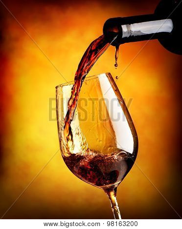 Red wine on orange background