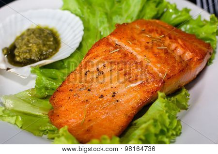 Salmon Steak With Lettuce And Pesto Sauce