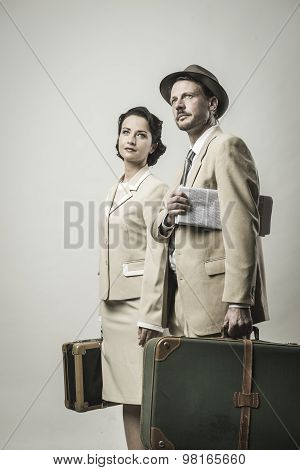 Elegant Couple Leaving With Luggage
