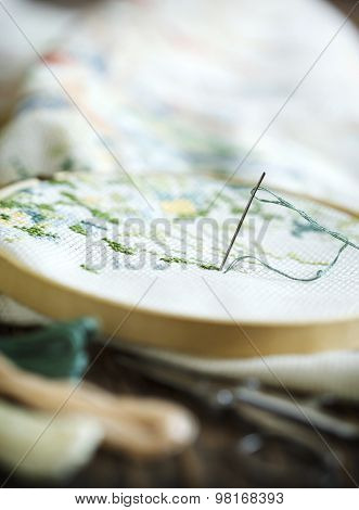 The Process Of Working A Cross-stitch Embroidery.