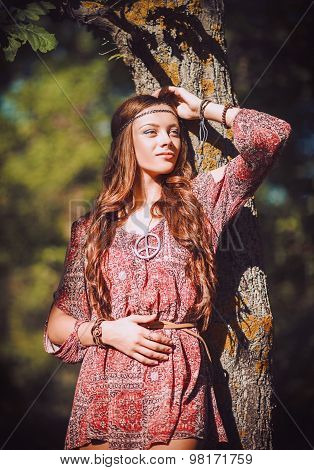 Portrait Of Beautiful Young Hippie Girl Standing Near Tree