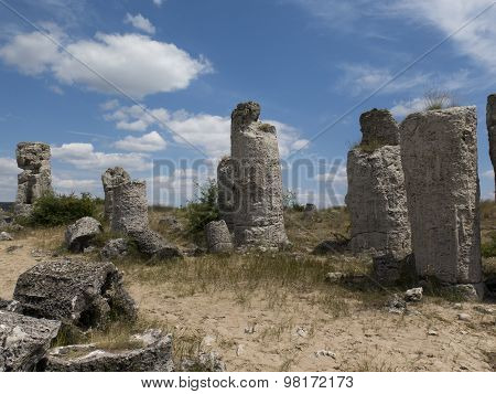 Stone Pillars On The Background Of Blue Sky, An Ancient Geological Phenomenon