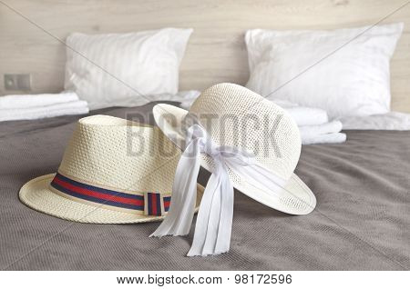 Man And Woman Hats On A Hotel Bed - Holiday Time
