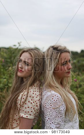 Two Teenage Girls Back To Back
