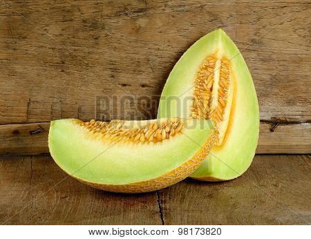 Yellow Cantaloupe Melon On The Wooden Background