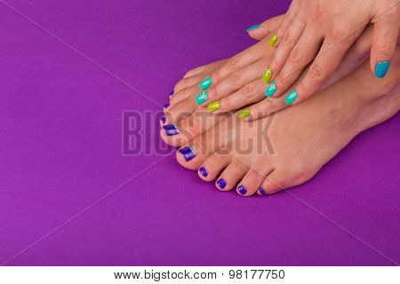 Beautiful pedicure in purple tones