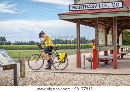 MARHTSVILLE, MO, USA - AUGUST 1, 2015: A touring cyclist at Marthasville stop on Katy Trail (237 mile bike trail stretching across most of the state of Missouri converted from abandoned railroad)