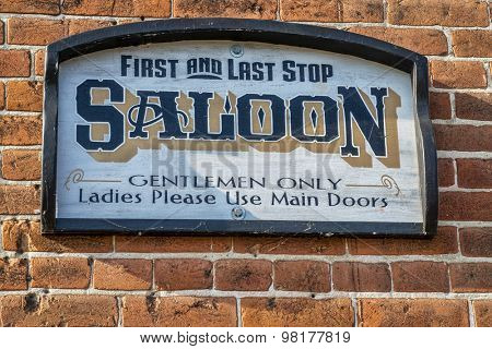 HERMANN, MO, USA - AUGUST 2, 2015: Gentlemen only - retro style saloon sign on historic White House Hotel in Hermann town riverfront.