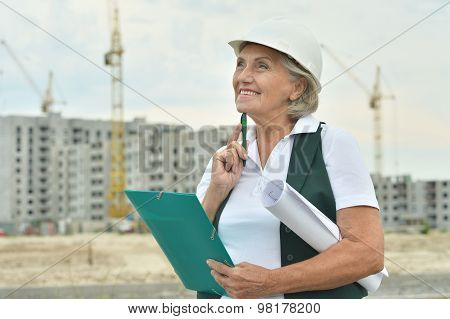 Senior  woman  in under construction