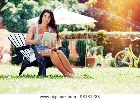Checking Her Email In The Garden