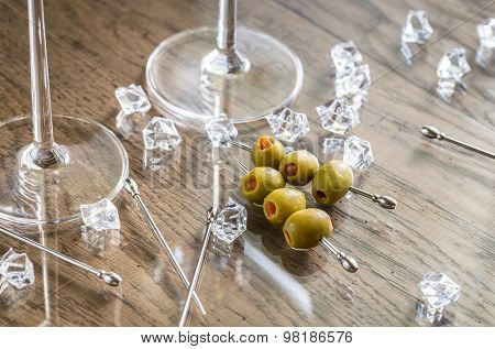 Two Martini Glasses With Olives On Martini Picks