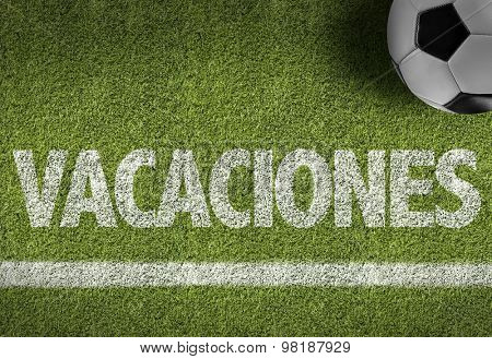 Soccer field with the text: Vacation (in Spanish)