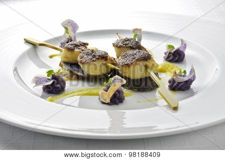 Fish Dish Skewer Of Scallops Crusted With Black Rice And Purple Potatoes