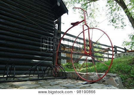 Red penny-farthing, velocipede