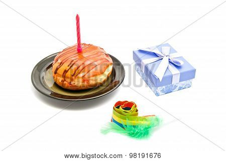 Donut With Pink Birthday Candle, Gift And Whistle On White