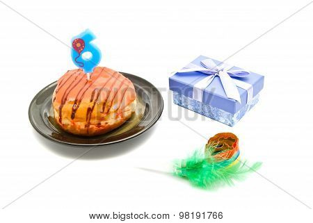 Donut With Six Years Birthday Candle, Whistle And Gift On White