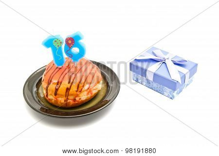 Donut With Sixteen Years Birthday Candle And Gift