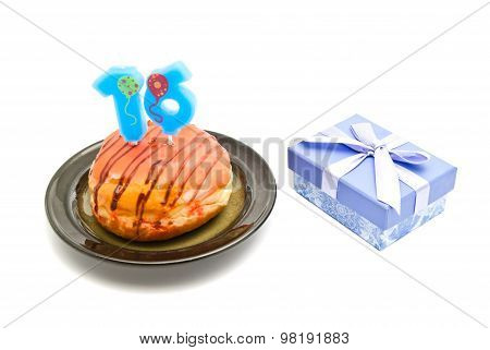 Donut With Sixteen Years Birthday Candle And Gift On White