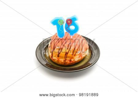 Donut With Sixteen Years Birthday Candle On White