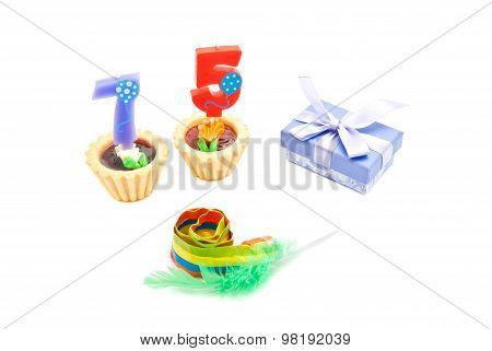 Cakes With Seventy Five Years Birthday Candles, Whistle And Gift On White