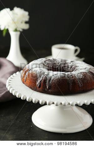Chocolate Bundt Cake On Cake Stand On Black Background