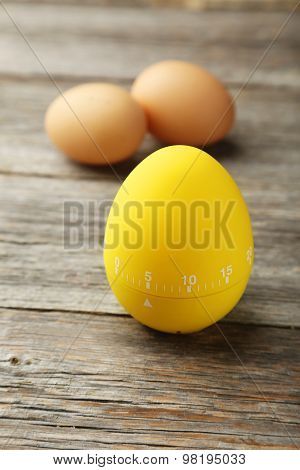 Yellow Egg Timer On Grey Wooden Background