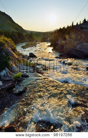 Sunset Near Swiftcurrent Lake And Whitewater Rapids In Glacier National Park