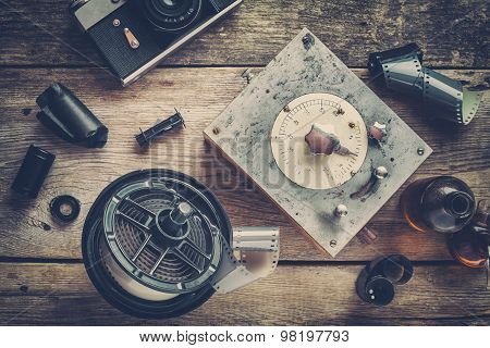 Developing Tank With Its Film Reels, Film Rolls, Cassette, Retro Camera, Timer, And Chemical Reagent