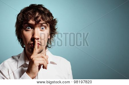 Closeup Portrait Of Handsome Young Shocked Business Man, Silent Young Business Man Shows The Gesture