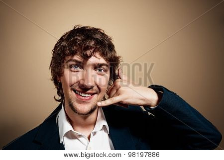 Closeup Portrait Of Handsome Young Business Man Looking At Camera And Gesturing Mobile Phone Near Hi