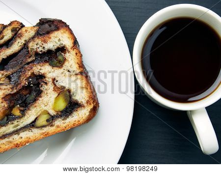 Slice Of Bread Cake And A Cup Of Tea On Table