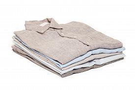 pic of apparel  - ironing housework ironed folded shirts clean concept still life garment apparel cloth indoors white background - JPG