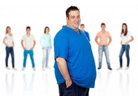 stock photo of morbid  - Smiling fat woman with unfocused people of background - JPG