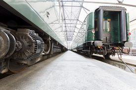 pic of passenger train  - Old authentic green passenger trains in a depot for renovation before being used for tourist trips across Europe - JPG