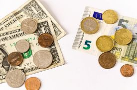 picture of two dollar bill  - two group of bills and coins of euros and dollars lay over white face opposing - JPG