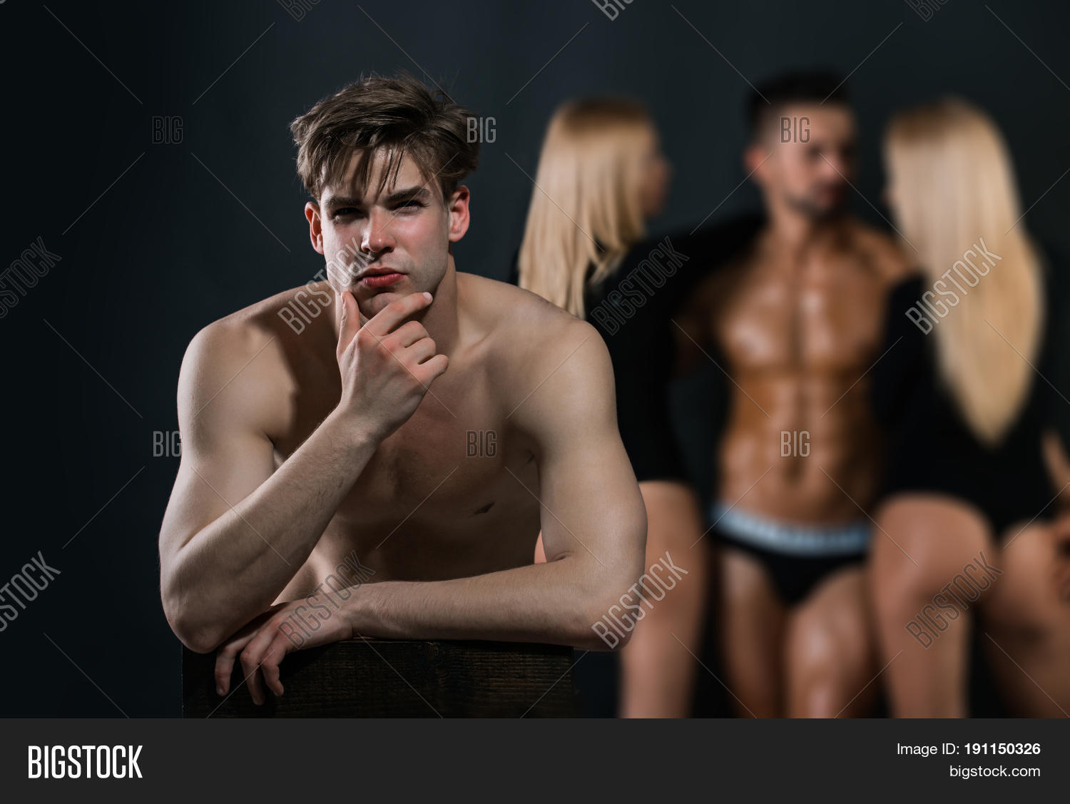 Thoughtful Man With Bare Chest Near Guy And Women Stock Photo ...