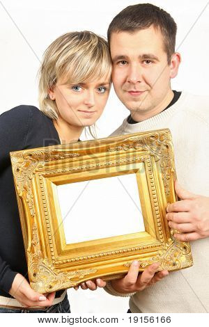 man and woman holding old gold frame