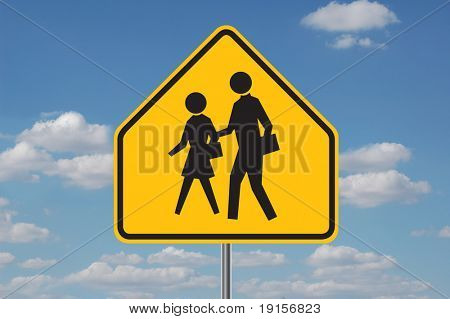 Schools warning sign with clouds in the background